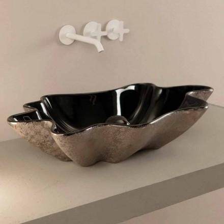 Umývadlo s čalouněním v černém a stříbrném keramickém provedení vyrobené v Itálii Rayan